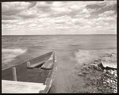 2018-04-22 Ukraine Foma 100 in DDX 1+4 8 min002-02web (Yuriy Sanin) Tags: ukraine boat yuriysanin lake largeformat landscape sea stones 8x10 blackandwhite bw юрийсанин большойформат чб чернобелаяфотография камни море черкасская каневское лодка облака clouds