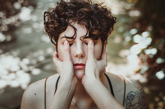 Sometimes it's better not to see (Laura Callsen) Tags: light bokeh closed eyes portrait woman short curly hair green soft focus hands closing vsco
