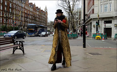 `2258 (roll the dice) Tags: london imposter sad mad fun funny surreal pretty sexy gir streetphotography shops shopping bargain sale people natural classic art england urban unaware unknown portrair stranger candid tourism tourists canon hot sunny weather bored happy reaction makeup madame tall short magic leopard mobile phone talk legs traffic cars coach bank bakerstreet w1 westminster hat trees stilts freak boots dark shadows