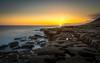 Almost gone - Southerndown - 22-4-18 (scamart1st) Tags: sunset glow colour warm calm wales uk southerndown alien sun sea long longexposure water coast rocks rays nikon 24120