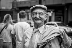 If You're Happy And You Know It (Leanne Boulton (Away)) Tags: portrait urban street candid portraiture streetphotography candidstreetphotography candidportrait streetportrait eyecontact candideyecontact streetlife old elderly man male aged face expression smile smiling happy happiness mood feeling emotion eyes cap tone texture detail depthoffield bokeh naturallight outdoor light shade city scene human life living humanity society culture people canon canon5dmkiii 70mm ef2470mmf28liiusm black white blackwhite bw mono blackandwhite monochrome glasgow scotland uk