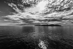 L'île d'Entrée - At Peace With Nature, View From The Ferry (SNAPShots by Patrick J. Whitfield) Tags: ferry boat land water sea ocean waves wet landscapes island peace lines patterns textures details dof reflections skies clouds cloudscapes bw bnw blackwhite blackandwhite noire shadows highlights life outside nature silhouette