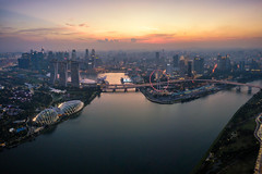 Aerial view of the Singapore landmark financial business district at twilight sunset scene with skyscraper and beautiful sky. Singapore downtown (MongkolChuewong) Tags: aerial aerialview architecture asia bay building business city cityscape district dome downtown drone exterior famous ferris flyer garden hotel landmark landscape laser light marina night panorama park river sands sea show singapore singaporecity singaporean sky skyline skyscraper southeastasia sunrise sunset tourism tower travel traveler twilight urban view water waterfront wheel sg