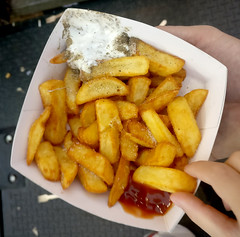 dipping out of the red corner (n.a.) Tags: chips mayonnaise pepper tomato ketchup potato cardboard container winter wonderland hyde park london hands fingers