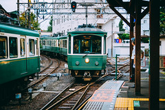 (hans-johnson) Tags: enoshima enoden electric railway shonan shounan kamakura kanagawa train tetsu tetsudo rail japan nihon nippon tokyu dentetsu canon eos 5d vsco odakyu streetcar tram vehicle transit transport transportation 江ノ電 江ノ島 湘南 鎌倉 日本 鉄道 レール railroad 火車 sky vehicles traffic street colorful colourful color colour urban city metropolis metropolitan tour trip travel blue winter bleu azul japon jp rainy 5d2 24105mm station platform green cloudy publictransport publictransportation capture nice life light people autumn man asia