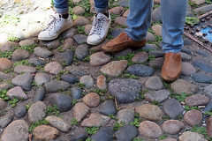 No Acorns ... but lots of rocks (PDX Bailey) Tags: shoe feet rock stone grass loafer tennis look down massachusetts boston acorn street history historic america americana shadow shadows pants jeans