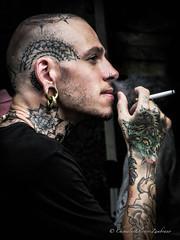 Chill out (stormymayen) Tags: smoking smoke tattoo guy cigarette earing ear hand bald blackshirt