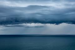 Raining Sideways (Aaron Springer) Tags: michigan northernmichigan lakemichigan thegreatlakes stormclouds weather bluehour minimalism outdoor nature waterscape