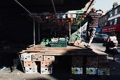 IMG_3289 (JetBlakInk) Tags: brixton brixtonmarket markettrader marketstall streetphotography magichour bananas tradingplaces men
