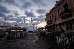 Quiet streets at dawn (ijpears) Tags: chania crete harbour greece lighthouse boats people tourist sunrise sunset seas sea skies ionian