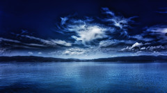 Nightswimming 3 (Alfred Grupstra) Tags: nature landscape sky water sea scenics blue cloudsky lake beautyinnature outdoors tranquilscene summer cloudscape reflection mountain nopeople sunset dusk coastline macedonia mk albania ohridlake