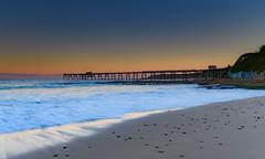 Sunset Seascape and Coal-loader Wharf (Merrillie) Tags: sand landscape sunset seashore nature swansea wharf newsouthwales waves coalloader nsw coalloadingwharf beach ocean lakemacquarie sea bay coastal seascape natural waterscape catherinehillbay coast australia seaside