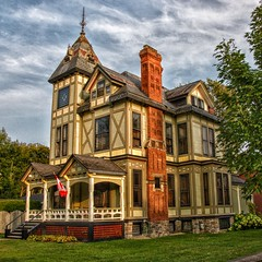 Brockville Ontario - Canada - Dunkeld House ~ High Victorian Architecture  - Susan and John MacKenzie Mansion  - 1880 (Onasill ~ Bill Badzo) Tags: canon sl1 18250mm sigma lens macro eos rebel dunkeld susan john a mackenzie house 375 king st w brockville on built ca 1880 ont ontario canada leedscounty greenvillecounty high victorian architecture style historic heritage hwy 2 tower attraction site walking tour onasill road tree sky building home mansion spiral hdr hard bokehs clouds grass