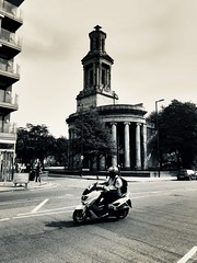 moped learner in front of peace garden. (zazaginz) Tags: pointshoot streetphotography urbanphotography blackwhite birminghamuk peacegarden vehicle moped