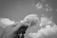 cotton candy (Uniquva) Tags: flickrfriday riceup clouds bw hand candyfloss spunsugar