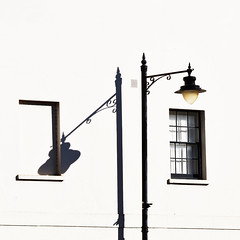 Shadows of themselves (Arni J.M.) Tags: wall window brickedup shadowsofthemselves windowtax streetlamp glass shadow mirroring ornament shades airvent windsor england uk