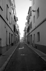 narrow (Gabo Barreto) Tags: mahon menorca balearicislands spain baleares street windows sign road film 35mm blackandwhite monochrome selfdeveloped scannedfromfilm epsonv500 analoguephotography filmisnotdead rangefindercamera vivitar35es ilfordhp5 xtol ishootfilm