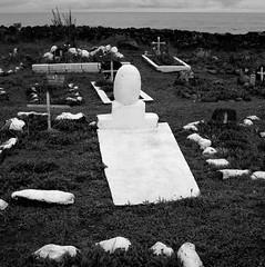 White Grave, Hanga Roa, Easter Island (austin granger) Tags: grave cemetery hangaroa easterisland rapanui death memorial time memory sea square film gf670 stone