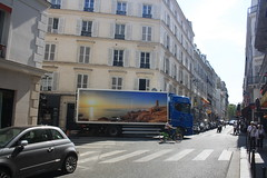 A truck and a bike (lazy south's travels) Tags: paris france french road street scene urban lorry truck bike motor building architecture shop cafe