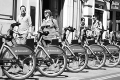 Probably more demand for tandems.... (markwilkins64) Tags: markwilkins santander bellaitalia bella tflbikes tfl summer sunshine smile smiles women men bw blackandwhite monochrome mono streetscenes streetphotography street london littleargylestreet bikes londonbikes sunglasses wheels couples friends