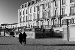 Today is the good old times of tomorrow (gambajo) Tags: 1year1town1lens brühl project blackandwhite blackwhite black white people couple outdoors public street streetphotography castle augustusburg shadows walk x100s fujix100s fujifilmx100s bright sunlight menschen schloesser schloss
