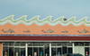Holden Beach, NC (Jeremy Whiting) Tags: dolphins new topographics city america beach ocean north carolina building tacky gaudy orange blue green waves surfs up canon digital windows shop shopping summer holiday resort town americana seashore urban