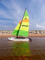 Reflection (Quetzalcoatl002) Tags: beach zandvoort sailing zeilboot vessel reflection sea seaside sky recreation sport catamaran sails