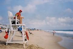 Lifeguard on duty (poavsek) Tags: kodak medalist ektar film maryland lifeguard beach sand water ocean