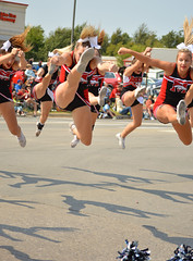 Kicking into action (radargeek) Tags: mustangwesterndaysparade 2017 september parade mustang oklahoma westerndays highschool mhs teen cheerleaders pom shadows jump kick ponytail