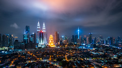 Cityscape of Kuala Lumpur Panorama at night. Panoramic image of skyscraper at Kuala Lumpur, Malaysia skyline at dusk. (MongkolChuewong) Tags: architecture asia asian blue building business capital center city cityscape dark district downtown dusk evening famous home house kl klcc kuala landmark landscape lumpur malaysia malaysian modern night office panoramic petronas place reflection scene sky skyline skyscraper summer sunrise sunset technology tower towers travel traveler traveller twilight twin urban view
