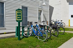 Patrol bikes (Jake (Studio 9265)) Tags: michigan usa united states america mi june 2018 up north outside outdoor sky island mackinac police patrol bike bikes sign green only department safety building blue white