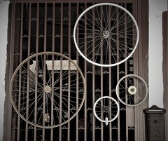 bicycle shop (SM Tham) Tags: asia southeastasia malaysia penang island georgetown unescoworldheritagesite building shop bicycle wheels display