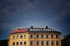 Read All About It (Douguerreotype) Tags: sky sweden city window buildings sverige stockholm architecture urban sign roof newspaper