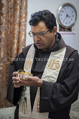 NA_131202_4368 (Custody of the Holy Land - Photo Service (CPS)) Tags: holyland michelshawkifahim parish terrasanta terresainte communion franciscan latinparish nadim pastoral sick vertical vicar visit