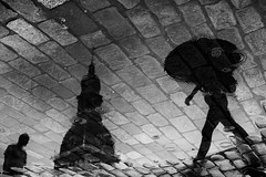 Dome square sketches: Fugue / 6:30pm (Mikhail Korolkov (OFF)) Tags: street streetphotography reflection silhouettes puddle brickroad rain raindrops blackandwhite monochrome riga dome domesquare umbrella
