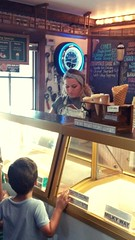 Waiting with Anticipation (PhotoJester40) Tags: indoors inside female male icecreamparlor blonde patiently composure amdphotographer
