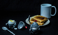 """A boiled egg in the morning is hard to beat."" (Beangrau12) Tags: dogwood2018 week17 creativehumor breakfast toast cup plate hardboiledeggs nikon3200 tamaron16300mm knightshapedeggholder food eggs"