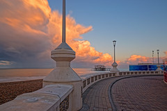 Morning Storm (Geoff Henson) Tags: clouds sky dawn daybreak blue pink promenade footpath walkway pavement wall beach sea water lamp light