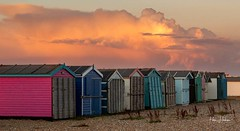Sunset reflects over the beach huts (Peter H 01) Tags: evening cloudporn clouds haylingisland seaside beach beachhuts goldenhour golden reflections sunset