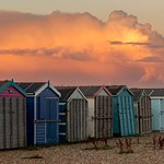 Sunset reflects over the beach huts thumbnail