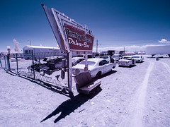 Bombay Beach Drive-In (Adventures in Infrared) (Torsten Reimer) Tags: coloradodesert usa sand desert northamerica himmel buildings drivein kino trees clouds wrecks california unitedstatesofamerica abandoned saltonsea bombaybeach autos seats infrared sky cars cinema sign infrarot wolken olympusepl5 calipatria unitedstates us