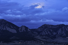 Moon Lantern (courtney_meier) Tags: boulder bouldercounty colorado coloradorockies fall flatirons frontrange landscape rockymountains southernrockies winter autumn bluehour city clouds dawn fullmoon moon moonset morning morninglight mountains sunrise wintermoon