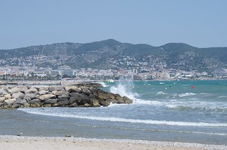 Heavy sea at Terramar and Sitges in the background.