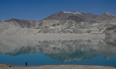 At the Edge (setoboonhong) Tags: nature lake river still water reflections sand dunes hills blue sky sunny fine day travel karakorum highway old silk road human figure scale landscape bulunkou