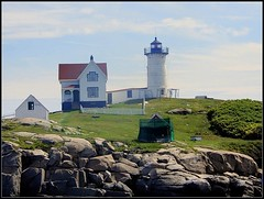 Nubble Light - Photo Taken by STEVEN CHATEAUNEUF On August 8, 2018 - Some Editing Was Done On August 12, 2018 (snc145) Tags: lighthouse fence grass hill cliff rocks outdoor nubblelight maine vacation photo august82018 august122018 stevenchateauneuf closeup sky bush summer seasons vividstriking flickrunitedaward