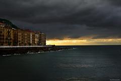 Rainy sunset (ricardocarmonafdez) Tags: donostia sansebastian ciudad city cityscape atardecer sunset cloudy cielo sky nubes clouds buildings arquitectura architecture mar sea nikon d850 24120f4gvr naturaleza nature