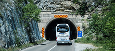 2018 - Serbia - Donji Milanovac (Ted's photos - For Me & You) Tags: 2018 cropped nikon nikond750 nikonfx serbia tedmcgrath tedsphotos vignetting bus tunnel donjimilanovac road novumtravel shadow red redrule donjimilanovacserbia roadway netting arch vehicle