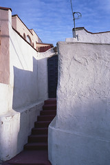 Stucco entry (ADMurr) Tags: la franklin hills adobe entry white shadow steps wall sky vertical leica m6 kodak ektar dad207