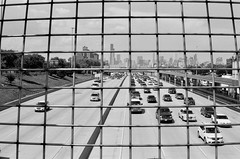 Dan Ryan (Crawford Brian) Tags: danryanexpressway chicago i94 interstate cars publictransit train cta chicagotransitauthority 35thstreet searstower skyline illinois urban transportation overpass bw film blackandwhite monochrome fpp400 nikon nikonfm analog automobiles fpp filmphotographyproject chicagowhitesox orwon74plus thedarkroomcom