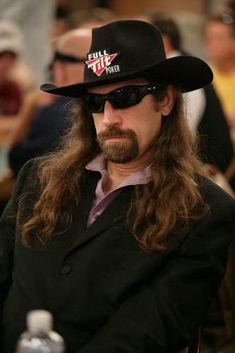 Sunglasses and hat at poker table